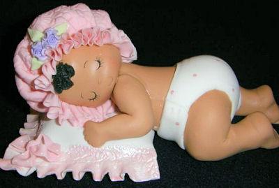 baby girl sleeping on pillow